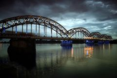 The bridge over the river with train in Riga Latvia by night stock photography