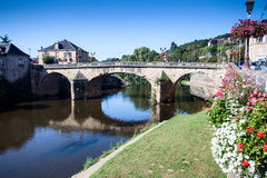 Bridge over River Vézère at Montignac. On the north bank looking west along the river Vézère towards the road bridge built in 1776 in the centre of the town Stock Images