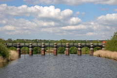 Bridge over River Weaver. Victorian sluice gate on River Weaver Royalty Free Stock Photos