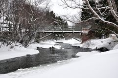 Bridge over river in Winter Stock Photo