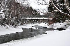 Bridge over river in Winter Stock Photo