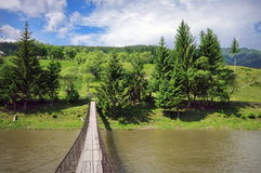 Summer landscape. Wooden Bridge over the river - Romania Royalty Free Stock Image