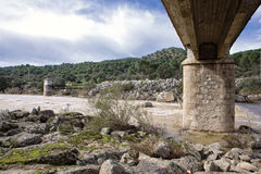 Bridge over the river yeguas near the central hydroelectric reservoir of Encinarejo. Near Andujar, Sierra Morena, province of Jaen, Andalusia, Spain Royalty Free Stock Photography