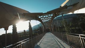 Bridge over road to modern elite resort on hot summer sunny day stock video footage