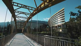 Bridge over road to modern expensive resort hotel on hot summer sunny day stock video footage