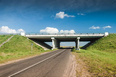 Bridge over the rural road Stock Image