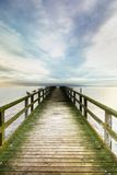 Bridge over the sea. Old sea bridge, hdr image, vertical Royalty Free Stock Images