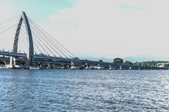 Bridge Bridge over the sea Modern bridge Access to the sea Sunny day Cars Tour Sea Architecture Modern structure. Bridge Royalty Free Stock Photos