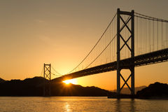 Bridge over the sea in the sunset Royalty Free Stock Photography