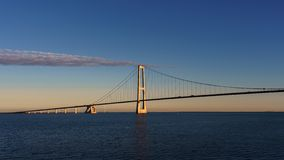 The bridge over the sea on which the transport goes. Morning. The sun beautifully illuminates the bridge. View from the bridge of stock images