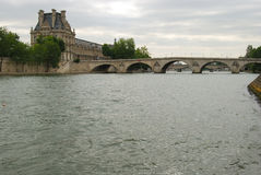 Bridge over Seine and Louvre museum stock photography