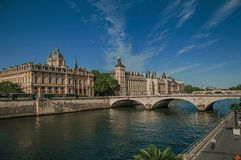 Bridge over the Seine River and the Conciergerie building with sunny blue sky at Paris. Stock Photography
