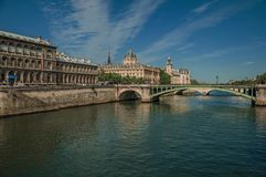 Bridge over the Seine River and the Conciergerie building with sunny blue sky at Paris. Stock Images