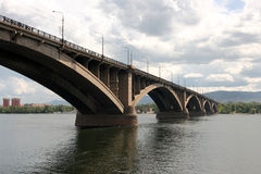 Bridge over Siberian Yenisei river. A view of long concrete bridge over the river Stock Photos