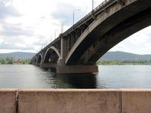 Bridge over Siberian Yenisei river. A view of long concrete bridge over the river Stock Image
