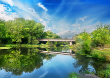 Bridge over silent river Royalty Free Stock Images