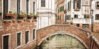 A bridge over a small canal, Venice Italy stock photo