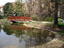 Bridge over small lake. In the citiy garden Stock Photography