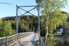 Bridge over a small river in the countryside of Norway, Europe, in early morning light. Stock Photos