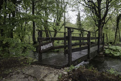 Bridge over a small river in forest Stock Images