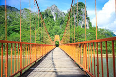 Bridge over song river in Laos Stock Photography