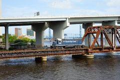 Bridge over st johns river and train. Train on Bridge over st johns river in Jacksonville downtown in Florida, USA royalty free stock image