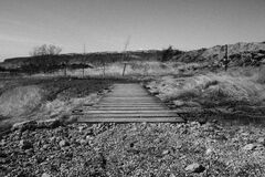Bridge over stream Stock Images