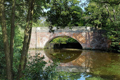 Bridge over a Stream. Red Brick Bridge over a lake in an English park Stock Photography