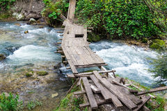 Bridge over a stream Royalty Free Stock Image