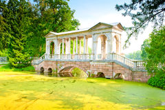 Bridge over  swamp in the famous park of Pushkin, Russia Royalty Free Stock Photography