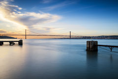 Bridge over the Tagus River in Lisbon. View of the bridge over the Tagus River in Lisbon, Portugal, at sunset Stock Images