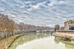 Bridge over the Tiber river in the center of Rome Royalty Free Stock Image