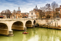 Bridge over the Tiber river in the center of Rome Stock Photos