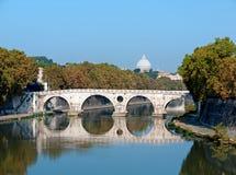 Bridge over the Tiber river, Rome. Sixtus bridge (Ponte Sisto) over the Tiber river, with the dome of the Saint Peter's basilica in the background, Rome, Italy stock photos