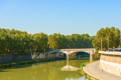Bridge over Tiber river in Rome, Italy. Rome, Italy - August 30, 2014: Traffic in Rome around the bridge. The bridge is connecting two sides of Tiber river Royalty Free Stock Photography