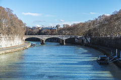 Bridge over the Tiber River in Rome, Italy Stock Images