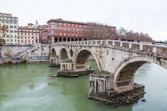 Bridge over Tiber river in Rome, Italy Stock Images