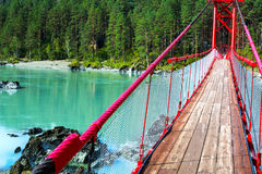 Bridge over turquoise river Royalty Free Stock Images