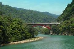 Bridge over turquoise river in Taiwan. Scenic bridge near Wulai in Taiwan stock images