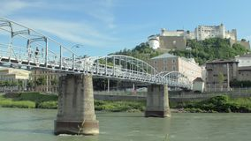Bridge over view Salzach river and view on Hohensalzburg Fortress in Salzburg stock video footage