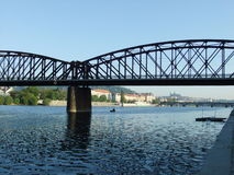 Bridge over the Vltava river. Beatiful sunny day in Prague with a view on the iron bridge Royalty Free Stock Photo