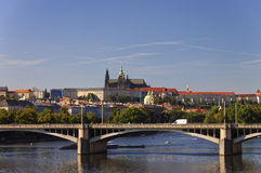 Bridge over the Vltava river in Prague on a nice summer day with the Saint Vitus cathedral and Prague castle in the background Royalty Free Stock Image