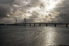 Bridge over water. In cloudy weather Stock Photography