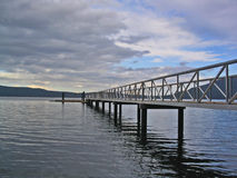 Bridge over water. With cloudy sky stock photography