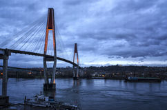 Bridge over Water during Blue hour. A shot of a road suspension bridge over water at dusk Royalty Free Stock Images