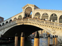Bridge over a water canal in Venice Stock Images