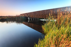 Bridge over water in early morning light Royalty Free Stock Photos