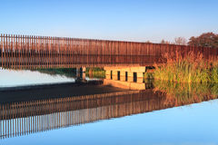 Bridge over water in early morning light Royalty Free Stock Photo