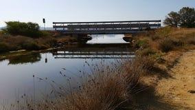 Bridge over water. Porto Pino pond, Sardinia Italy Royalty Free Stock Photos