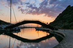 Brigde reflection in the water by sunset. Bridge over the water with reflection in the water by sunset royalty free stock photos